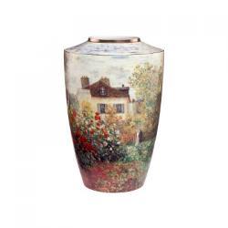 Vaza are inaltimea de 18 cm si reprezinta o reproducere a picturii The atist house a celebrului pictor Jean Claude Monet Materiale portelan foita de aur