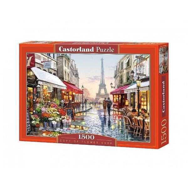 Un puzzle format din 1500 de piese de calitate care atunci cand este finalizat masoara 680 mm x 470 mmDimensiunea aproximativa a unei piese este 213 cm2O imagine cu un magazin de flori din Paris