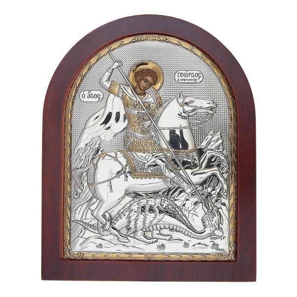 Icoana Argintata cu Sfantul Gheorghe – Purtatorul de biruinta Este fabricata in Grecia Are aplicat Sigiliul Producatorului Poate fi asezata pe birou sau pe pereteInfatiseaza pe Sfantul Gheorghe dimensiuni 11x13cm