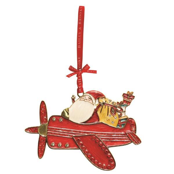 Decoratiune din metal sub forma avionului lui Mos Craciun vesel colorata decorata cu cristale si glitterArticolul vine insotit de cutie de prezentare cu fundita decorativa si interior placut la atingereUn cadou elegant si pretios pentru un Craciun memorabil